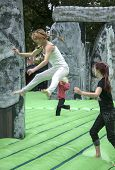 Teenager bouncing in the air on the life-sized inflatable replica of Stonehenge