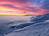 Majestic Sky With Pink Cloud. Fantastic Sunrise Illuminates The Mountain, Thick Fog And Horizon. Sno poster