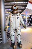 Old Vintage Three-bolt Deep-sea Diving Suit. Suit For Deep Sea Diving Of The Last Century. The Histo poster
