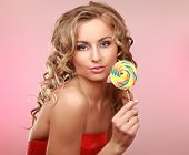 young happy woman with  lollipop