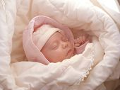 stock photo of baby face  - dreaming sweet baby girl wrapped soft blanket