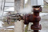 large rusty valve is broken.