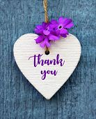 Thank You Or Thanks Greeting Card With Purple Flower And Decorative White Heart On Blue Wooden Backg poster