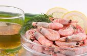 Delicious cooked shrimp with spicy greens, lemon and beer poster