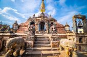 Sacred Gompa. Sculptures Of Gods And Goddesses Carved On The Stone Of Ancient Buddhist Temple And An poster