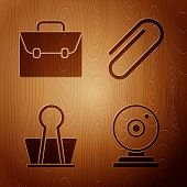 Set Web Camera, Briefcase, Binder Clip And Paper Clip On Wooden Background. Vector poster