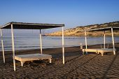 View Of The Beautiful Beach Through A Balinese Bed.sun Beds With A Roof And Canopies On The Promenad poster