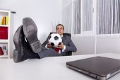 Mature football businessman manager working at the office