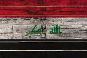 National Flag  Of Irak On A Wooden Wall Background. The Concept Of National Pride And A Symbol Of Th poster