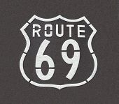 Route 69 sign painted on pavement.