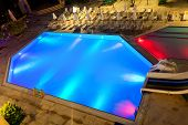 Illuminated Swimming Pool At Night
