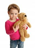 Young Child Holding A Teddy Bear