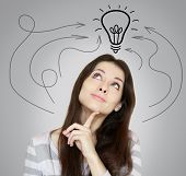 Thinking Young Woman Thinking With Arrows And Light Idea Bulb Above Head