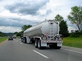 stock photo of big-rig  - big fuel gas tanker truck on highway - JPG