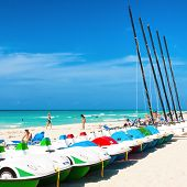 VARADERO,CUBA-APRIL 7:Boats for rent and tourists enjoying the beach April 7,2013 in Varadero.With a