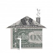 A house shape made from dollar bills with dollar signs rising from chimney symbolizing the housing crisis.