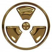 Radiation symbol made of gold isolated on white