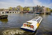 View On Amsterdam And Amstel Rive With Cruise Boats , The Netherlands