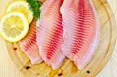 Fillets Tilapia With Lemon On A Round Board