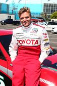 LOS ANGELES - APR 9:  Brett Davern at the Toyota ProCeleb Race Press Day 2013 at the Toyoto Grand Pr