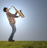 Saxophonist. Portrait of a man playing on saxophone