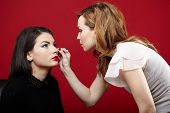 Woman Having Makeup Applied By Makeup Artist