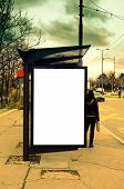 image of bus-shelter  - Bus station with blank poster on stormy day - JPG