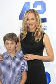 LOS ANGELES - APR 9: Kim Raver, son Luke Boyer at the Los Angeles Premiere of '42' at TCL Chinese Th