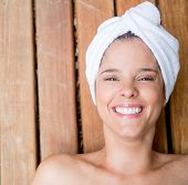 Beautiful woman wearing a towel in her head smiling