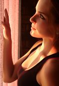image of blinders  - Beautiful young adult caucasian woman wearing a black top looking at the sunset through the blinders at her window - JPG
