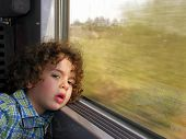 Little boy bored train journey