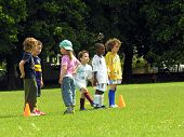 Kids play football in the park