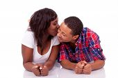 Happy Young Black African American Couple Lying Down On The Floor -- African People