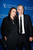 NEW YORK-NOV 21; John McEnroe and wife Patty Smyth attend the American Museum of Natural History's 2013 Museum Gala at American Museum of Natural History on November 21, 2013 in New York City.