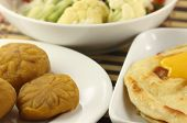 pic of barfi  - Parotta with barfi and vegetables close up