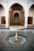 Moroccan Mosaic Floor And Wooden Door
