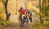 DNIPRODZERZHYNSK, UKRAINE - OCTOBER 26 : Members of bicycle race competition passing last kilometers