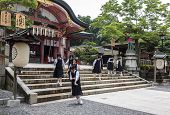 High School Girls Wearing School Uniforms At Fushimi Inari Shrine In Kyoto, Japan