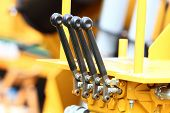 picture of levers  - Close up detail of levers knobs on new tractor machinery industrial detail - JPG