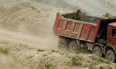 stock photo of chimes  - huge truck on a coal mine open pit - JPG