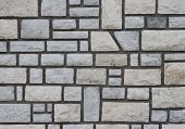 Stone wall with cement.
