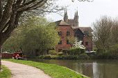 River Scene With Narrow Boat & House