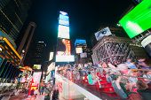 People And Guests On Night Times Square