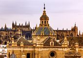 stock photo of 1700s  - Church of El Salvador Iglesia de El Salvador Dome with Cross Seville Andalusia Spain Under Stormy Skies - JPG