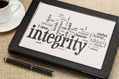 cloud of words or tags related to integrity and ethical values on a  digital tablet