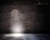 picture of loneliness  - Background image of dark wall with light spot - JPG