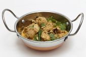 image of curry chicken  - A kadai serving bowl of balti chicken pasanda curry - JPG