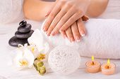 french manicure and wnite orchid flower