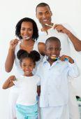 Smiling Family Brushing Their Teeth