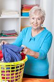 Elderly Woman Sorting Laundry